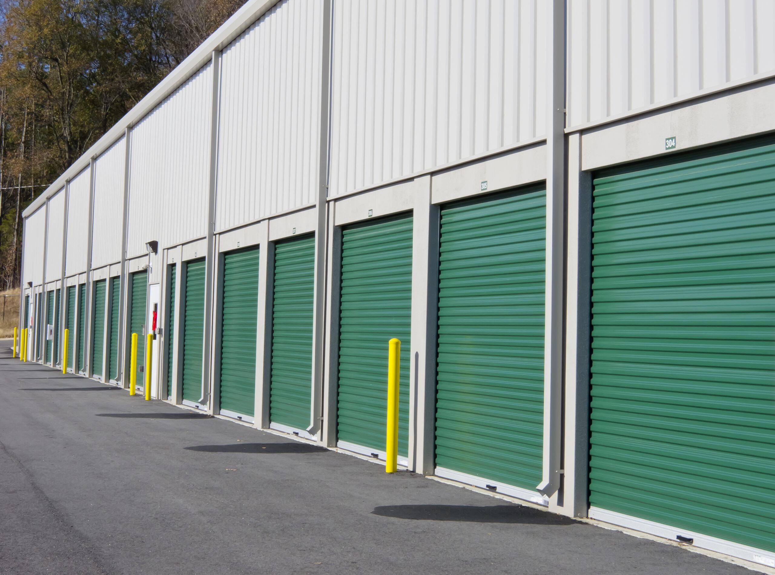 Row of outdoor green door self-storage units