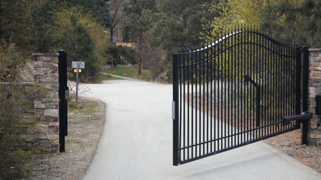automatic steel gate opening on a long driveway